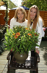 Left to right, MARY NIGHTINGALE and CHELSEA LLOYD daughter of news journalist Terry Lloyd who was killed in Iraq  at the 2005 RHS Chelsea Flower Show on 23rd May 2005<br />