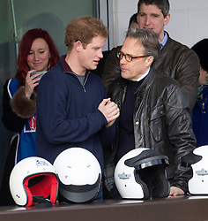 Prince Harry visits Goodwood Motor Circuit, Chichester, on behalf of the Endeavour Fund. Harry drove various cars, including an Aston Martin like his father Prince Charles\'. He also met Spitfire pilots and sat in a Spitfire. (Pictured here with Lord March) United Kingdom. Saturday, 15th February 2014. Picture by i-Images