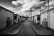 Temporary Hosue of Taro, December 2011..In the north east of Japan there is a small city called Taro that was completely destroyed by the tsunami on the 3/11. After the tsunami the whole population of 8000 people moved to the top of the mountain where they settled down.  .Here they had temporary housing, temporary shops, a japanese warm bath and a temporary clinic provided by MSF. Almost one year later they are still living there, they have created their own new little community village and this has became the new reality for them. In this small colony you can find barber shops, restaurants, grocery stores, schools and a playground just like a normal village. The colony is not far from the sea so, as the majority of the population from Taro are fishermen, they don't find it too hard to survive in their new environment. From a temporary shelter this has became the new TARO Village.