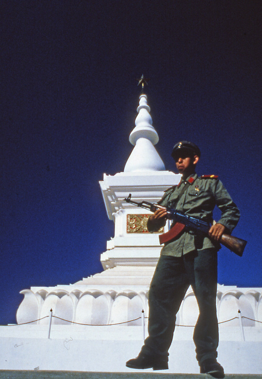 Pathet Lao soldier guards memorial to Pathet Lao independence, Lao Independence memorial, Vientiane, National monument Laos, tour attractions in Vientiane Laos, Southeast Asia independence, IndoChina independence memorials, Vientiane tours Asia