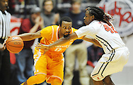 "Tennessee Volunteers guard Kevin Punter (0) is defended by Mississippi Rebels guard Stefan Moody (42) at the C.M. ""Tad"" Smith Coliseum in Oxford, Miss. on Saturday, February 21, 2015. Mississippi won 59-57. (AP Photo/Oxford Eagle, Bruce Newman)"