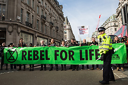 London, UK. 9th March, 2019. Climate activists from Extinction Rebellion hold a flashmob noise protest at Oxford Circus on a theme of 'Sound in the Rebellion' to call on the Government to take immediate steps to combat the current climate and ecological emergency.