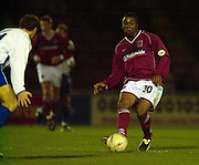 06/12/2003 - Photo  Peter Spurrier.FA Cup 2nd Rd - Northampton v Weston S Mare.Nothamptons Des Lyttle knocks the ball  through the gap.