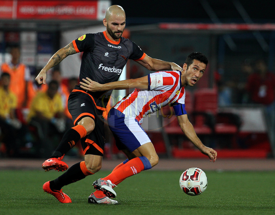 Atletico de Kolkata captain Luis Javier Garcia Sanz and Hans Mulder of Delhi Dynamos FC in action during match 7 of the Hero Indian Super League between Atletico de Kolkata and Delhi Dynamos held at the Salt Lake Stadium in Kolkata, West Bengal, India on the 19th October 2014.<br /> <br /> Photo by:  Vipin Pawar/ ISL/ SPORTZPICS