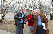 Cedar Rapids Recreation Superintendent Sven Leff (from left), Task Force member Dale Todd, and City Council member Scott Olson look at the property layout at the J Ave NW and Ellis Blvd NW location as members of the Northwest Recreation Center Task Force take a bus tour of the five possible sites for a new recreation center in Cedar Rapids on Thursday morning, February 23, 2012. (Stephen Mally/Freelance)