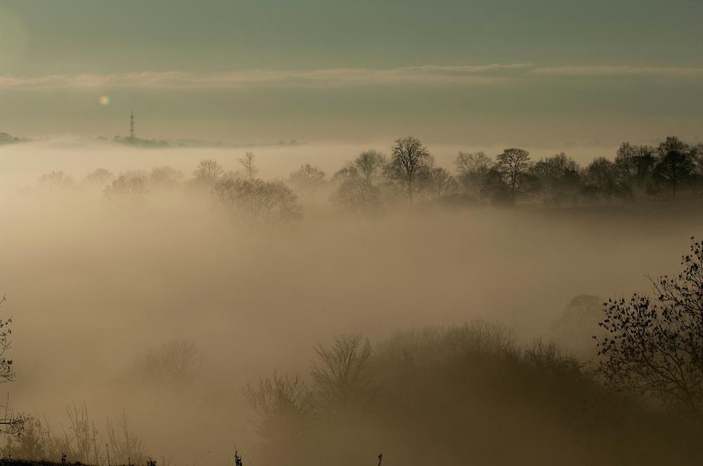 Mist over the Peak District town of Ashbourne, Derbyshire, England, UK.