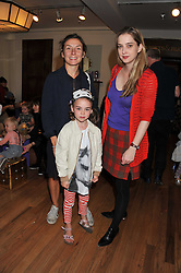 Left to right, NATASHA LAW, her daughter ONDINE and DAISY DE VILLENEUVE at a Hello Kitty Event at Liberty to lauch their collection of Hello Kitty products at Liberty, Great Marlborough Street, London on 25th September 2011.