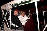 Patrick & Sherri McClelland of Miamisburg get ready to take a ride during Horse-Drawn Carriage Rides & Star Late Skate night at RiverScape MetroPark in downtown Dayton, Saturday, December 18, 2010.