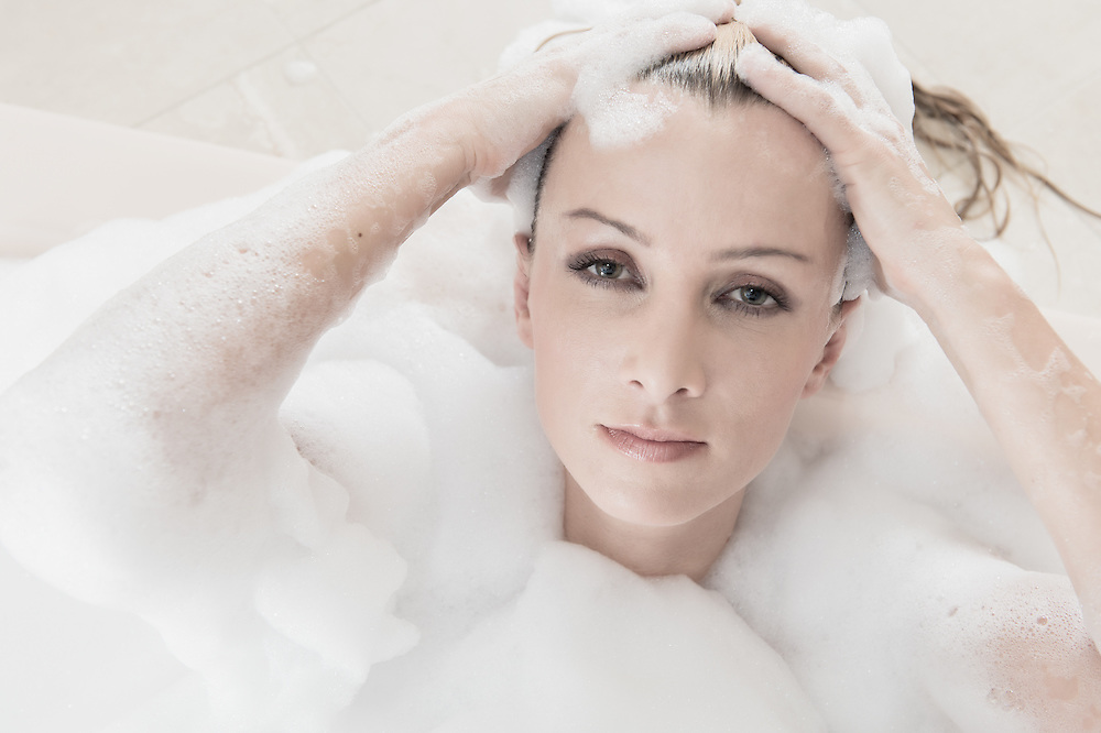 Portrait of sensual woman relaxing in a Spa looking at camera.