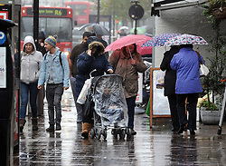 © Licensed to London News Pictures. 06/11/2013<br /> Wet weather today (06.11.2013) in Kent.<br /> A rainy day for shoppers at  Orpington High Street,Kent.<br /> Photo credit :Grant Falvey/LNP