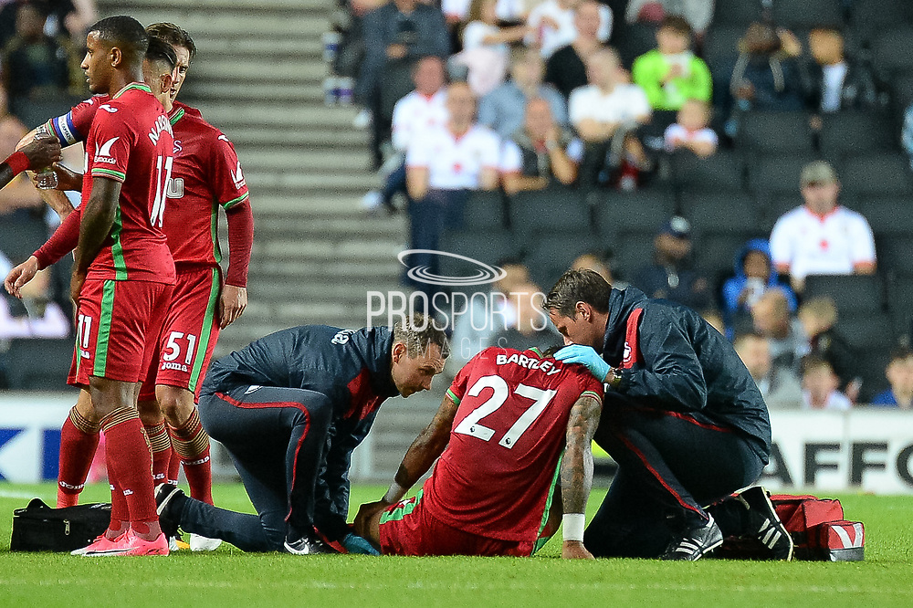 Swansea City defender Kyle Bartley (27) is injured during the EFL Cup match between Milton Keynes Dons and Swansea City at stadium:mk, Milton Keynes, England on 22 August 2017. Photo by Dennis Goodwin.