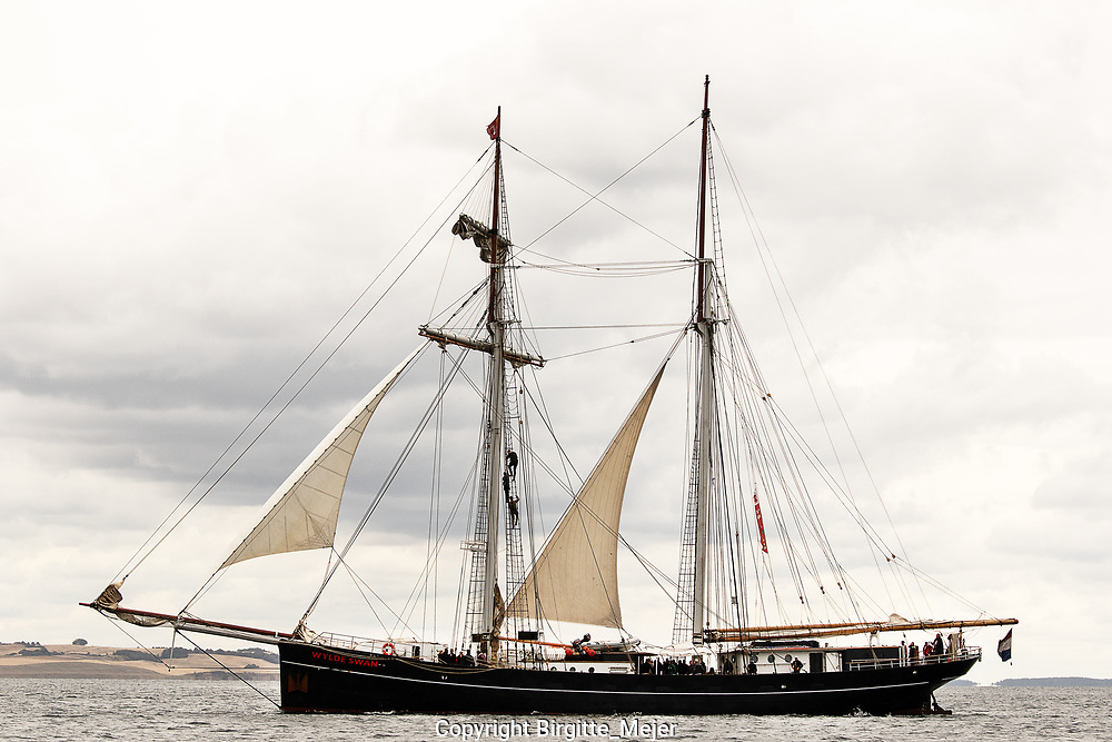 The Dutch sailing vessel Wylde Swan is a ship built for speed. She started life as a motor vessel in the 1920's and brought fresh herring from the fishing grounds to markets ashore. Her slender hull is reminiscent of the large schooner yachts of the 1900 era.<br /> <br /> Wylde Swan is the largest two-mast topsail schooner in the world. Built to win races, cross oceans and be sailed with passion. You are welcome to join us.