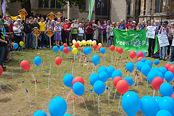 "Old Palace Yard, Westminster, July 25th 2015. Protesters gather outside the Houses of Parliament to demand electoral reform, including proportional representation rather than the first-past-the-post method that saw the Tories gain a majority. PICTURED: Popped ballons representing ""unrepresented"" votes stand amongst those still inflated representing parties that succeeded through thye first-past-the-post system."