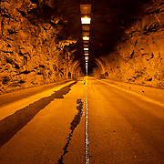 Wawona Tunnel in Yosemite National Park. This was taken in Spring pre-dawn with snow melt making it's way down the road.