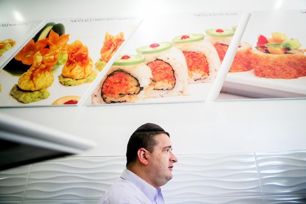 BROOKLYN, NY - JUNE 6, 2016: Elan Kornblum, publisher and president of Great Kosher Restaurants International, is interviewed inside the Noribar Sushi Lounge in the Borough Park neighborhood of Brooklyn, New York. CREDIT: Sam Hodgson for The New York Times.