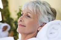 Senior woman relaxing at health spa