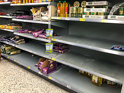 © Licensed to London News Pictures. 03/03/2020. London, UK. Empty shelves on the Rice aisle. Panic-buying starts to show in this ASDA store in Wandsworth as shelves empty out of goods. Earlier, Boris Johnson announced his battle plan in Downing Street for combating the coronavirus crisis. Photo credit: Alex Lentati/LNP
