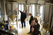 Tim Kovac, founder and brewmaster at Small Town Brewery gives an impromptu tour to of the brewery Richard Grahn, Robin Stearn, and Meira Stern who traveled from Maryland and found the brewery Friday, August  7, 2015, in Wauconda, ILL. Kovac brews an alcoholic root beer called Not Your Father&rsquo;s Root Beer which is 5.9% alcohol by volume, and also makes other unique beers. <br /> CREDIT: Rob Hart for The Wall Street Journal<br /> SLUG: ROOTBEER