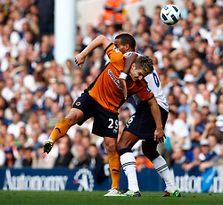 18.09.2010, White Hart Lane, London, ENG, PL, Tottenham Hotspur vs Wolverhampton Wanderers, im Bild Tottenham's Tom Huddlestone holds onto Kevin Doyle of Wolverhampton Wanderers. EXPA Pictures © 2010, PhotoCredit: EXPA/ IPS/ Kieran Galvin +++++ ATTENTION - OUT OF ENGLAND/UK +++++ / SPORTIDA PHOTO AGENCY