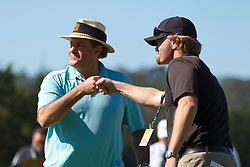Feb 8, 2012; Pebble Beach CA, USA; Television commentator Chris Berman (left) celebrates after making a putt to win the second hole during the celebrity challenge of the AT&T Pebble Beach Pro-Am at Pebble Beach Golf Links. Mandatory Credit: Jason O. Watson-US PRESSWIRE