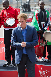 © London News Pictures. 22/04/2012. London, UK. HRH Prince Harry during a winners medal presentation at the 2012 Virgin London Marathon on April 22, 2012. Photo credit : Ben Cawthra /LNP