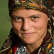 Young woman with headscarf and western clothes, Wakhan Valley