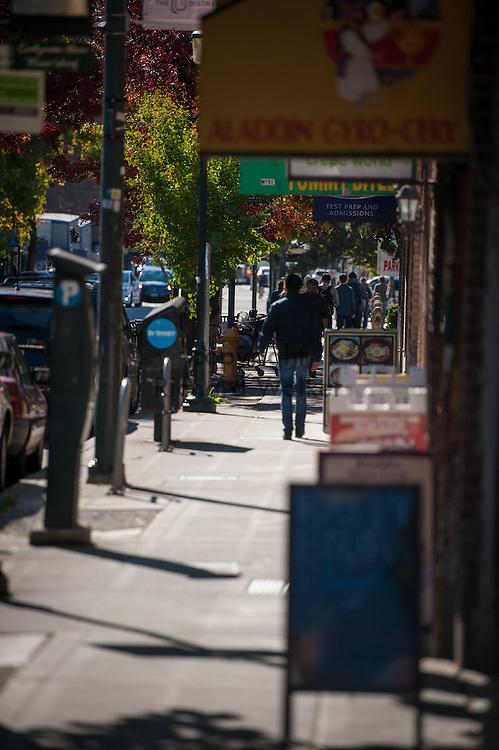 2016 October 11 - Pedestrians walk down University Way, University District, Seattle, WA, USA. By Richard Walker