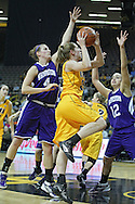 December 30, 2011: Iowa Hawkeyes forward Kelly Krei (20) puts up a shot as Northwestern Wildcats forward Kendall Hackney (4) and Northwestern Wildcats guard Allison Mocchi (12) defend during the NCAA women's basketball game between the Northwestern Wildcats and the Iowa Hawkeyes at Carver-Hawkeye Arena in Iowa City, Iowa on Wednesday, December 30, 2011.