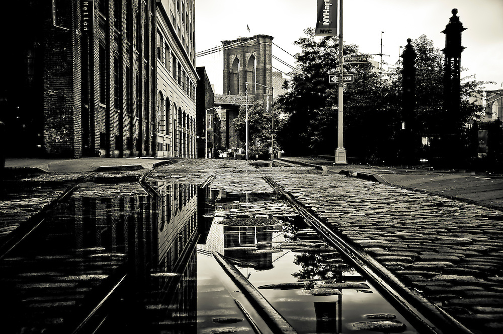 Reflection of the Brooklyn Bridge between old tracks in DUMBO, Brooklyn, 2009.