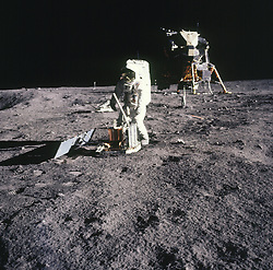 The Moon - (FILE) -- Apollo 11 astronaut Edwin Aldrin deploying the Early Apollo Science Experiments Package (EASEP) on Sunday, July 20, 1969. The package consists of a seismometer on the ground in front of Aldrin powered by a solar panel to the left. The white rod jutting out of the top of the instrument is the antenna to send the results back to Earth. Partially hidden behind Aldrin's right hand is the laser ranging retroreflector. via CNP Photo by CNP/ABACAPRESS.COM