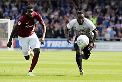 Junior Morias of Peterborough United in action with Leon Barnett of Northampton Town - Mandatory by-line: Joe Dent/JMP - 26/08/2017 - FOOTBALL - Sixfields Stadium - Northampton, England - Northampton Town v Peterborough United - Sky Bet League One