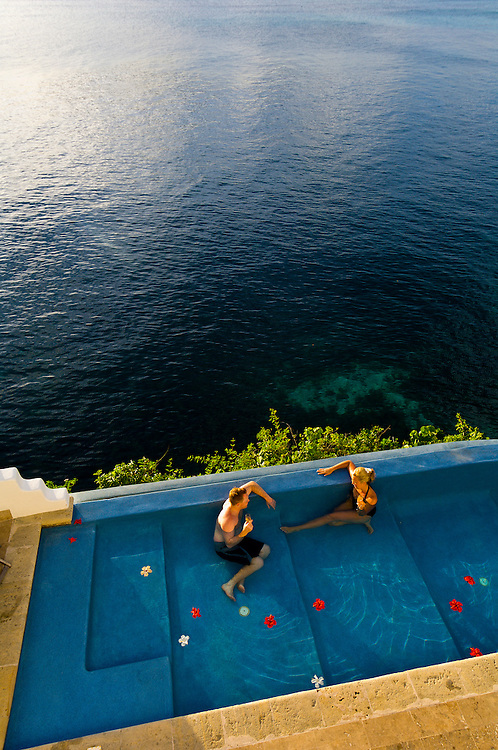 A couple on honeymoon enjoy a private swimming pool at a villa called The Point, above Vatulele Island Resort, Fiji Islands