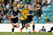 Paige Satchell and Clare Pokinghorne fight for possession during the Cup of Nations Women's Football match, New Zealand Football Ferns v Matildas, Leichhardt Oval, Thursday 28th Feb 2019. Copyright Photo: David Neilson / www.photosport.nz