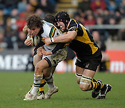Wycombe, GREAT BRITAIN,   Saints'. Lee DICKSON is tackled by Wasps' left George SKIVINGTON and Mark ROBINSON, during the Guinness Premiership rugby game, London Wasps vs Northampton Saints, at Adam's Park Stadium, Bucks, England, on Sun 22.02.2009. [Photo, Peter Spurrier/Intersport-images]