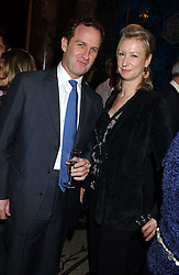 ALASTAIR TEDFORD and JOANNA JOHNSTON at a party hosted by Tanner Krolle held at Leighton House, 12 Holland Park Road, London W14 on 8th December 2005.<br /><br />NON EXCLUSIVE - WORLD RIGHTS
