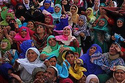 April 25, 2017 - Srinagar, Jammu and Kashmir, India - Mehraj-u-Alam was celebrated in Kashmir, which marks ascension day, the journey from Heaven to Earth of the Prophet Mohammed, at the Hazratbal Shrine in the outskirts of Srinagar, India. Hundreds of Muslims from different parts of Kashmir visit the Hazratbal shrine in Srinagar to pay obeisance on the Mehraj-ul-Alam. The relic is displayed to the devotees on important Islamic days such as the Mehraj-ul-Alam. (Credit Image: © Umer Asif/Pacific Press via ZUMA Wire)