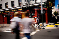 Brandon McGee finishes up a coffee delivery on Harrison St, in San Franicsco, Ca., on Monday, April 4, 2011. Bicycle Coffee Company is a San Francisco start-up taking green to a new level, by delivering hand-roasted coffee to over 100 local businesses, in addition to Whole Foods, by bicycle only. .Lianne Milton for The Wall Street Journal.Bay Area - Coffee Status