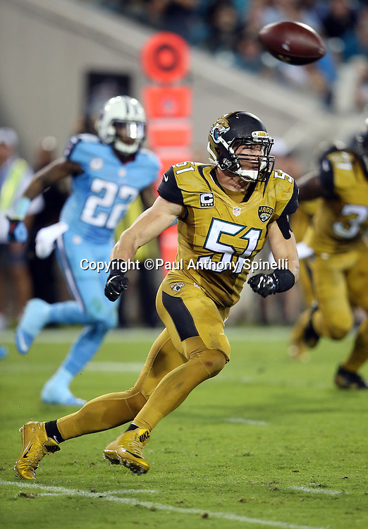 Jacksonville Jaguars middle linebacker Paul Posluszny (51) chases the action during the 2015 week 11 regular season NFL football game against the Tennessee Titans on Thursday, Nov. 19, 2015 in Jacksonville, Fla. The Jaguars won the game 19-13. (©Paul Anthony Spinelli)