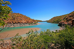 Outgoing tide at Silvergull Creek on the Kimberley coast.  vast mud and sandbanks are exposed at low tide.