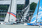 JP Morgan, Emirates Team New Zealand and Gazprom Team Russia. Day three of the Extreme Sailing Series regatta being sailed in Singapore. 22/2/2014