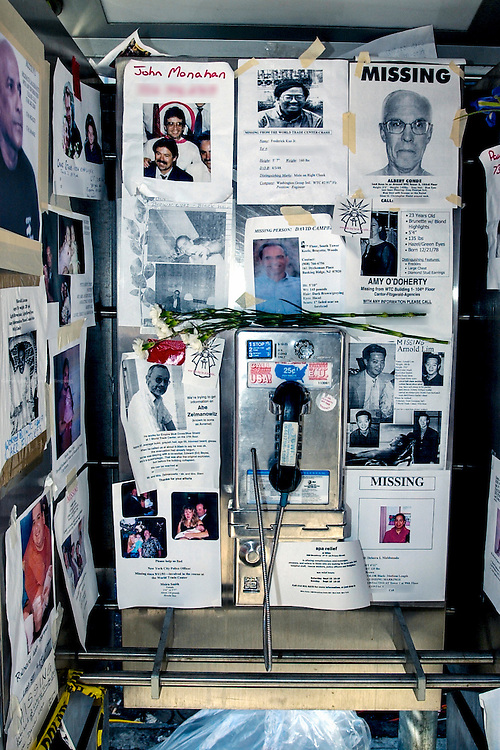 Posters of missing people cover the walls of a phone booth. In the days and weeks after the 9/11 attack, posters like these covered car windows and every available lamp post or phone booths.