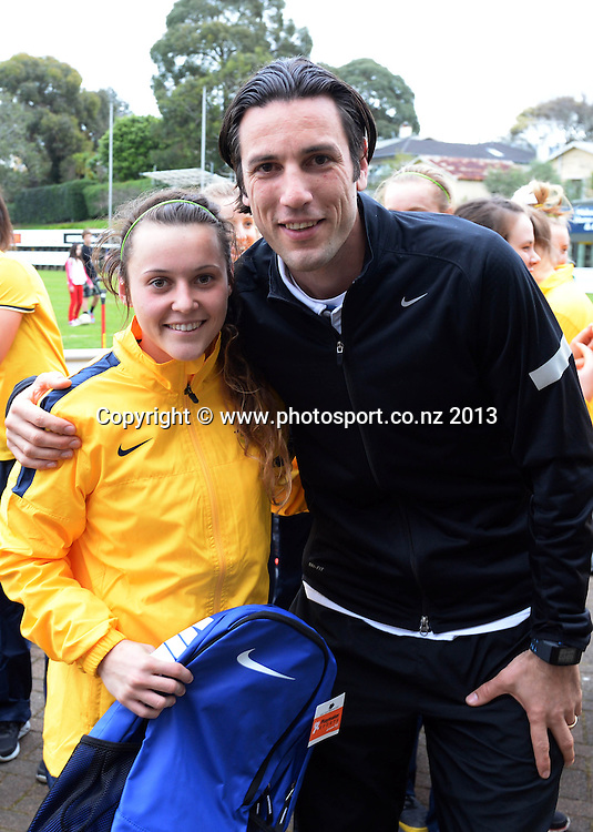 Australian player of the day poses for a photo with All Whites player Ivan Vicelich. New Zealand Junior Football Ferns v Australia Young Matildas. Women's U20 International. Kiwitea St, Auckland. Saturday 27 July 2013. Photo: Andrew Cornaga/www. Photosport.co.nz
