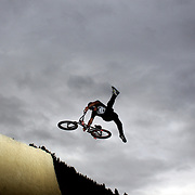 A competitor in action during the 'Red Bull Roast It' BMX competition with riders from around the globe competing at the Gorge Road Jump Park, Queenstown, South Island, New Zealand. 18th February 2012. Photo Tim Clayton