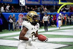 UCF Knights defensive back Antwan Collier (3) intercepts a pass from Auburn Tigers quarterback Jarrett Stidham late in the fourth quarter during the second half of the Chick-fil-A Peach Bowl NCAA college football game at the Mercedes-Benz Stadium in Atlanta, January 1, 2018. UCF won 34-27 to go undefeated for the season. (David Tulis via Abell Images for Chick-fil-A Peach Bowl)