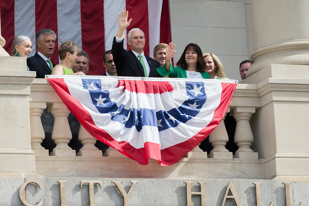Vice President Mike Pence, center and his wife Karen Pence, right, watch the St. Patrick's Day parade from the balcony at City Hall, Saturday, March 17, 2018, in Savannah, Ga. (AP Photo/Stephen B. Morton)