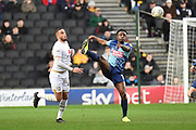 Wycombe Wanderers defender Anthony Stewart (5) clears his lines under pressure from Milton Keynes Dons forward (on loan from Norwich) Carlton Morris (23) during the EFL Sky Bet League 1 match between Milton Keynes Dons and Wycombe Wanderers at stadium:mk, Milton Keynes, England on 1 February 2020.