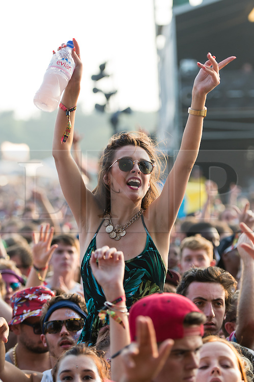 © Licensed to London News Pictures. 07/09/2014. Isle of Wight, UK. Bestival 2014 festival goers dance as Major Lazer performs on stage on Day 4 Sunday the final day of the festival. This weekend's headliners include Chic featuring Nile Rodgers, Foals and Outcast.   Bestival is a four-day music festival held at the Robin Hill country park on the Isle of Wight, England. It has been held annually in late summer since 2004.    Photo credit : Richard Isaac/LNP