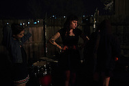 The Prettiots load out after a show during 35 Denton at Rubber Gloves in Denton, Texas on March 15, 2015. (Cooper Neill for The New York Times)