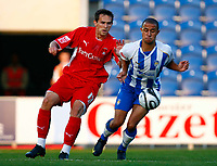 Football Carling Cup First Round Colchester United v Leyton Orient Ashley Vincent of Colchester United Charlie Daniels of Leyton Orient   at Weston Homes Community Stadium, Colchester 11/08/2009 Credit: Colorsport / Kieran Galvin