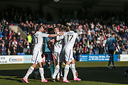 Tranmere players celebrate going 1-0 with what appears to be an own goal after Andy Warrington (Grimsby Town) fails to collect the ball during the Vanarama National League match between Tranmere Rovers and Grimsby Town FC at Prenton Park, Birkenhead, England on 30 April 2016. Photo by Mark P Doherty.